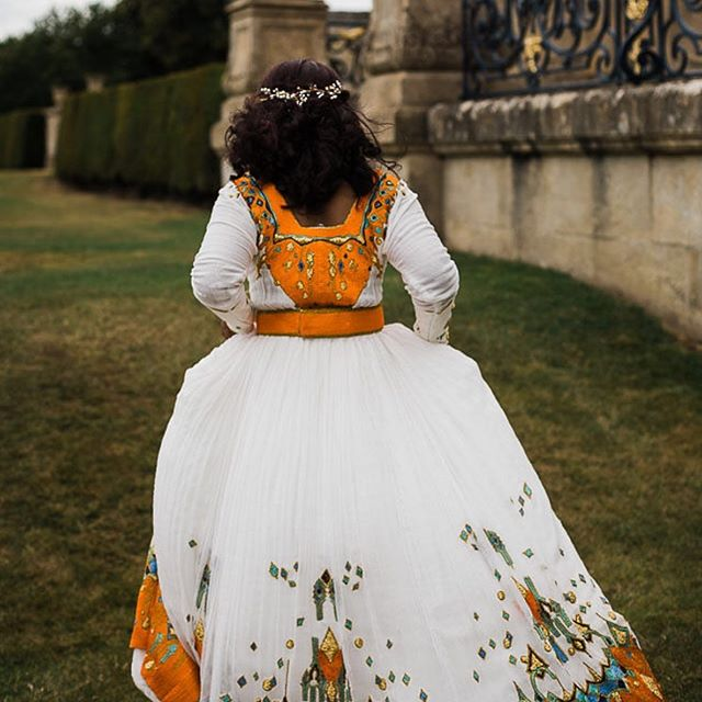 How beautiful is Delina's dress?! Every inch of it has been hand sewn and hand embroidered in a traditional Ethiopian style.  And the most amazing bright colours ✨  #walledgardens  #alternativebride  #somersetweddingphotographer  #hampshireweddingphotographer  #englishheritagewedding  #wrestparkwedding
