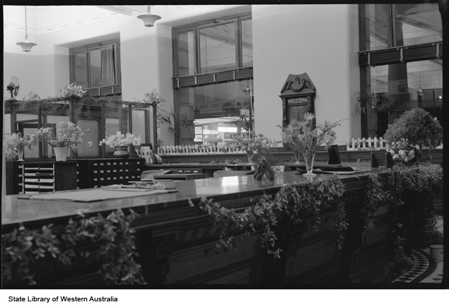 AMP Chambers service counter decorated for Flower Day, 1955