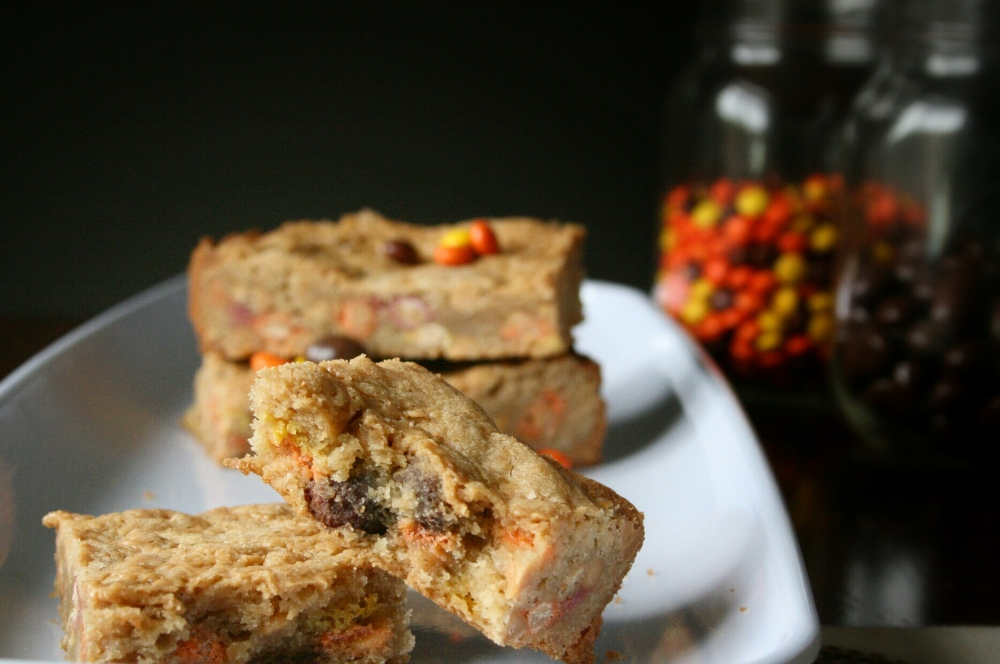chunky peanut butter lovers blondies with reeses pieces, chocolate covered peanuts and peanut butter chips