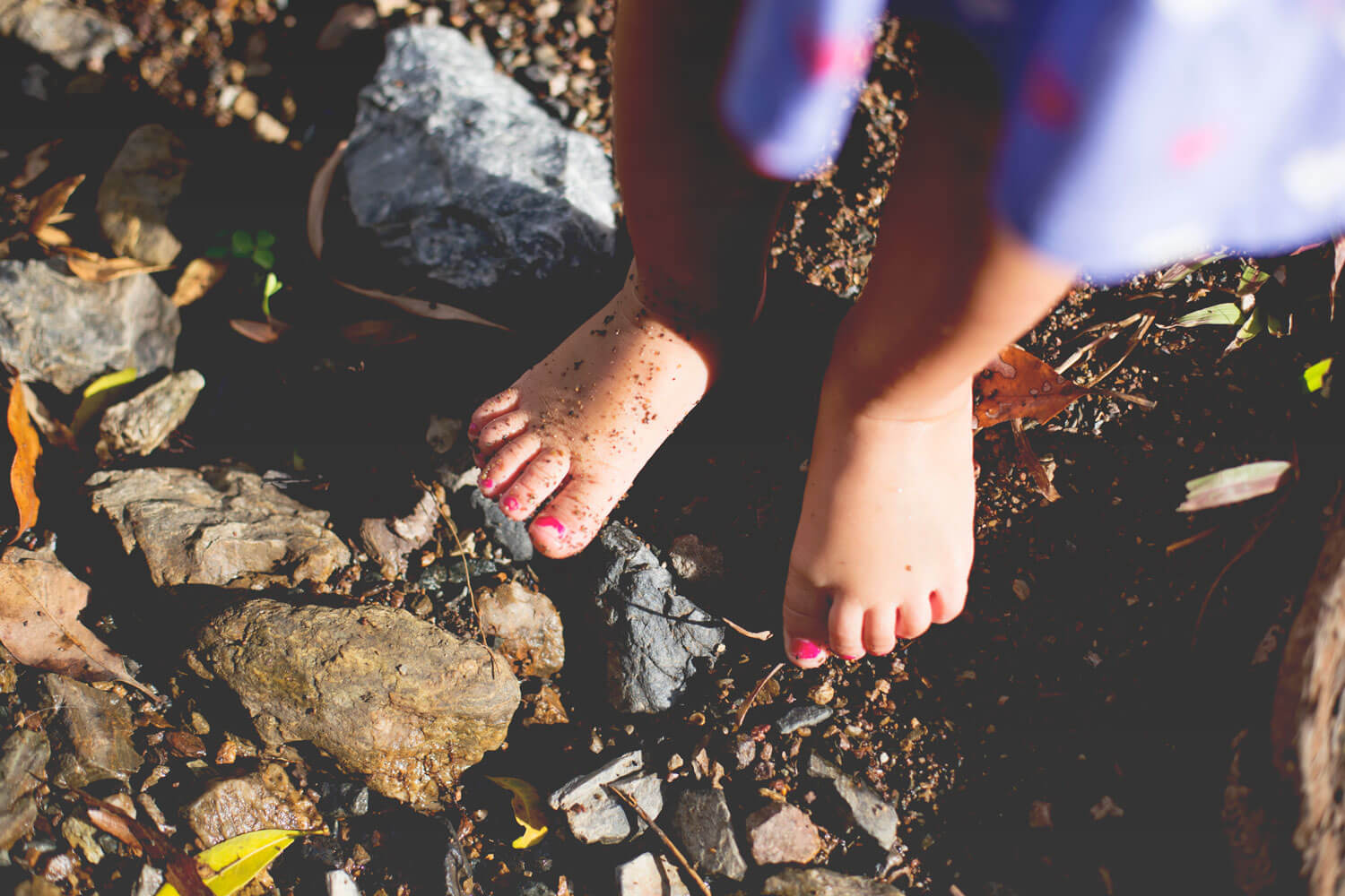 Little feet in the dirt during family photography shoot at Mt Coot-tha Brisbane