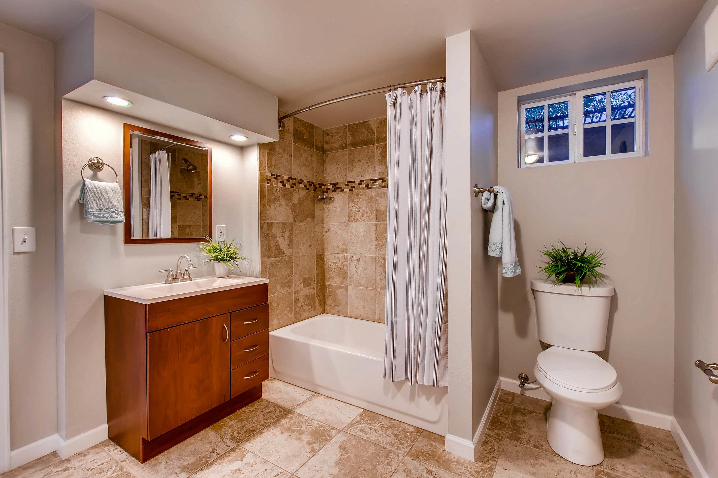 4409 Raritan St Denver CO-print-023-31-Lower Level Bathroom-3000x2000-300dpi.jpg