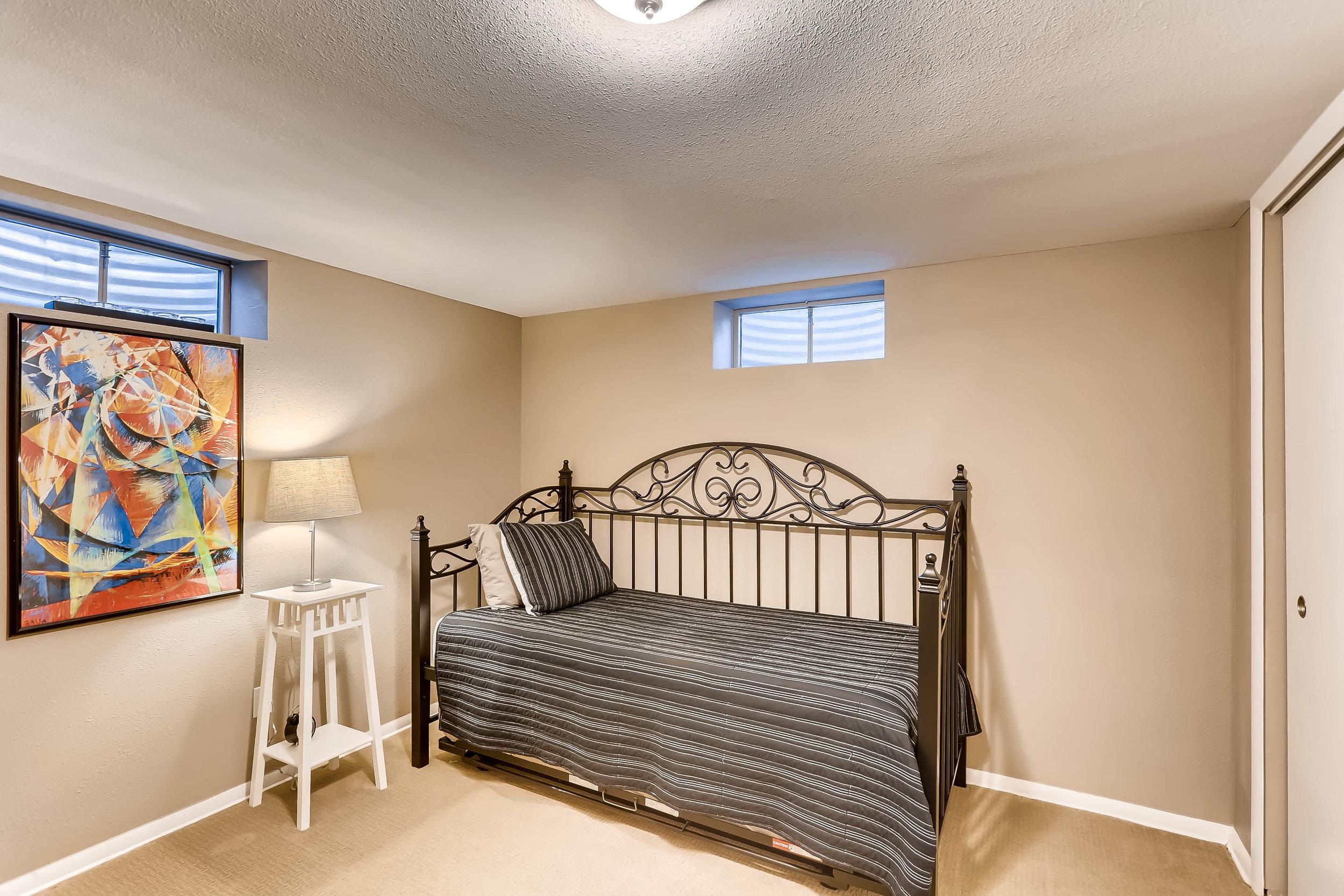 7330 E 12th St Denver CO 80220-print-022-23-Lower Level Bedroom-3600x2400-300dpi.jpg