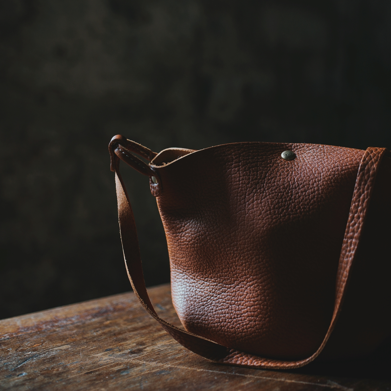 Brown leather handbag sits on a table during a photo shoot in Tasmania.