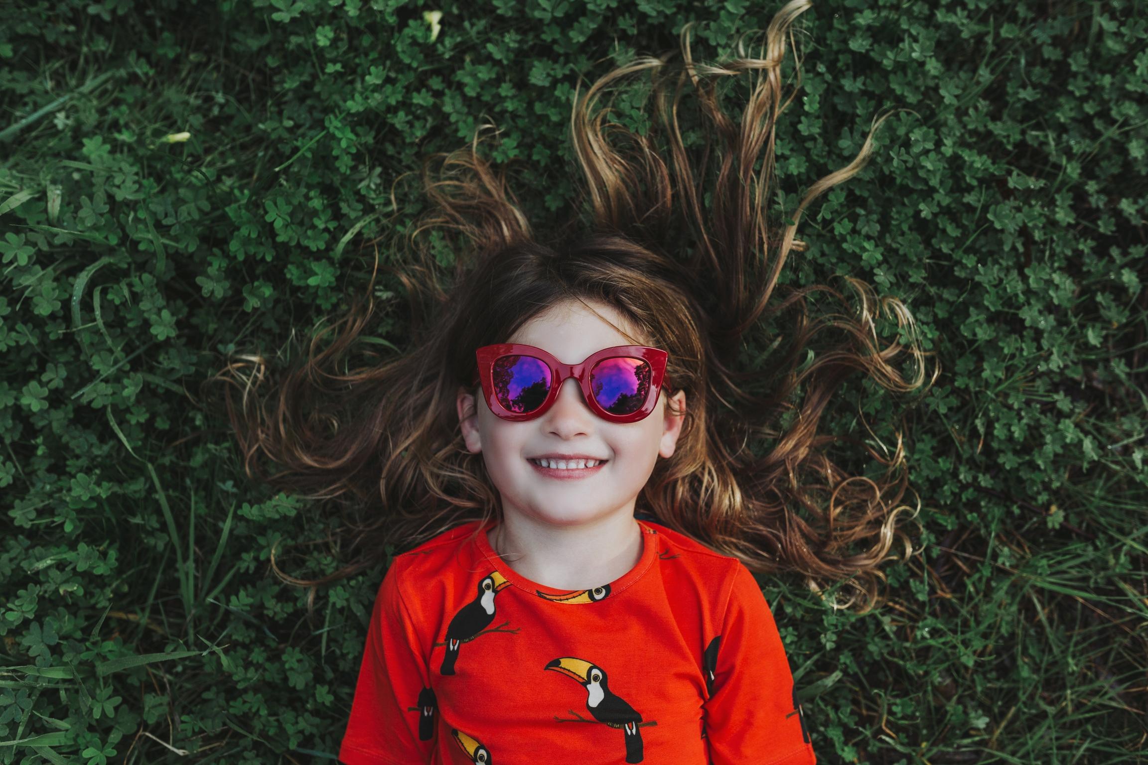 girl-smiles-sunglasses-fashion-photography-siida-tasmania.jpg
