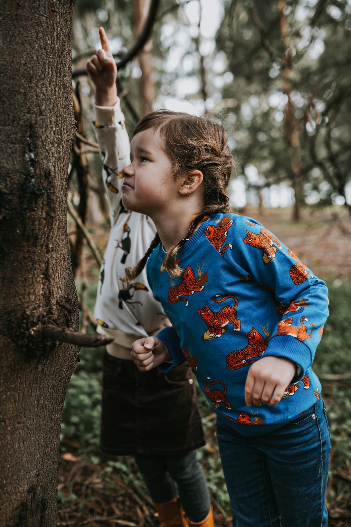 girl-explores-nature-blue-sweater-photography-siida-tasmania.jpg