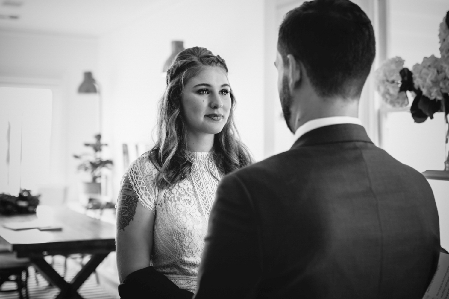 Documentary style photo of emotional bride says her vows during elopement to her husband at Quamby House Tasmania.