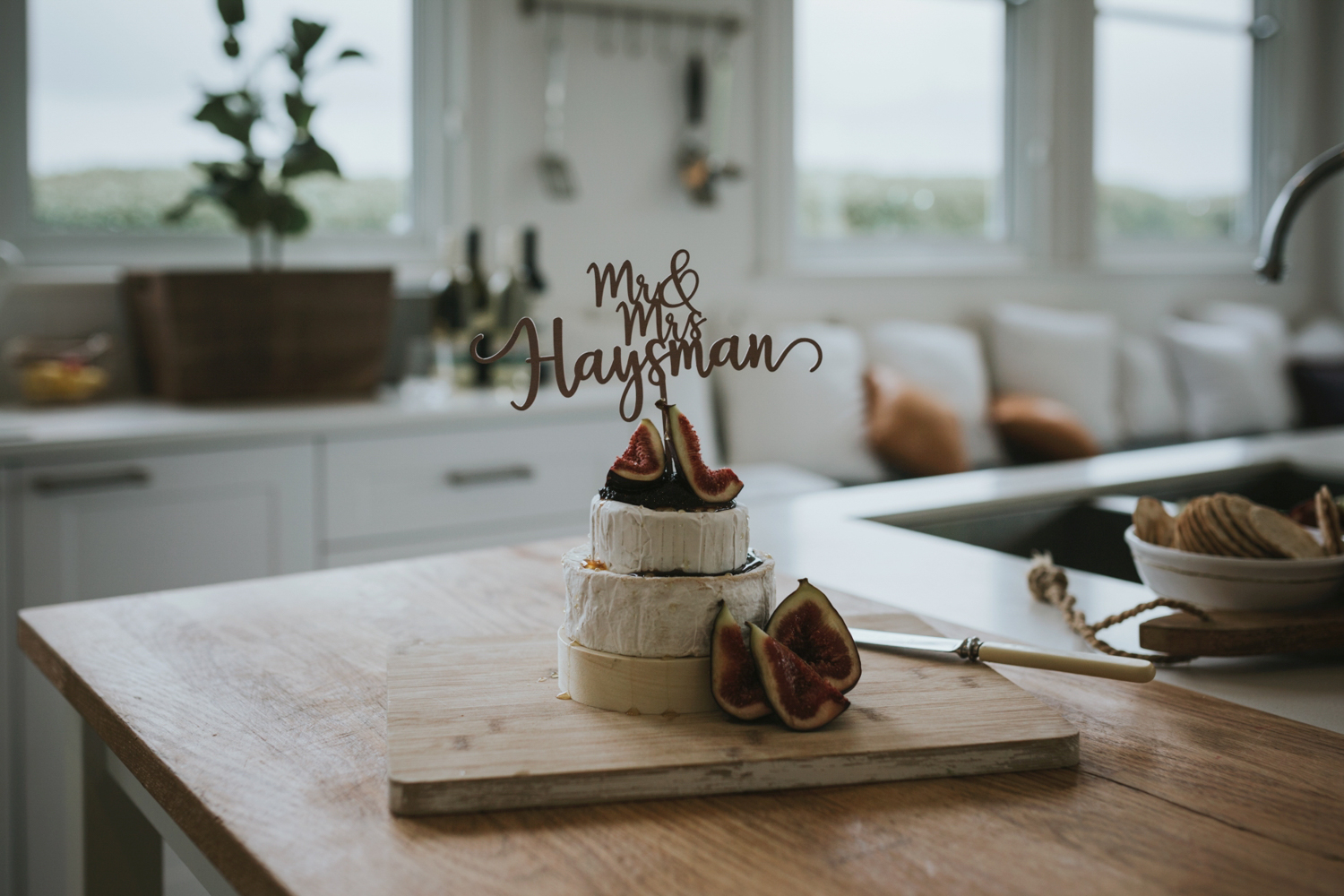Unique wedding cake made of soft cheese and fresh figs with Mr & Mrs signage on top.