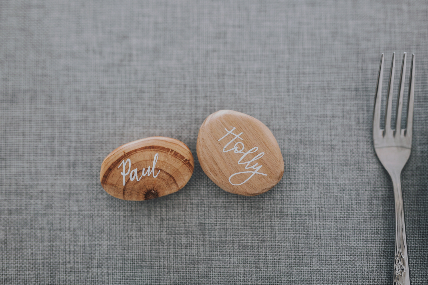 personalised wooden place card stones for stylish wedding at bay of fires tasmania.