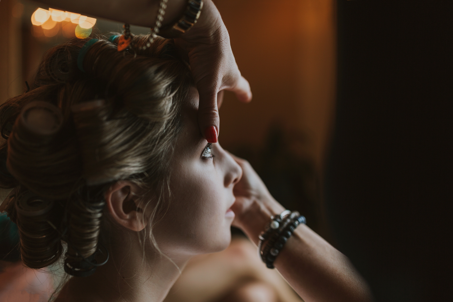 Moody image of bride having her make up done in the marriott hotel in Brisbane.