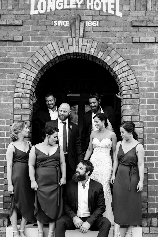 Bridal party enjoy a chat at Longley hotel in Tasmania.