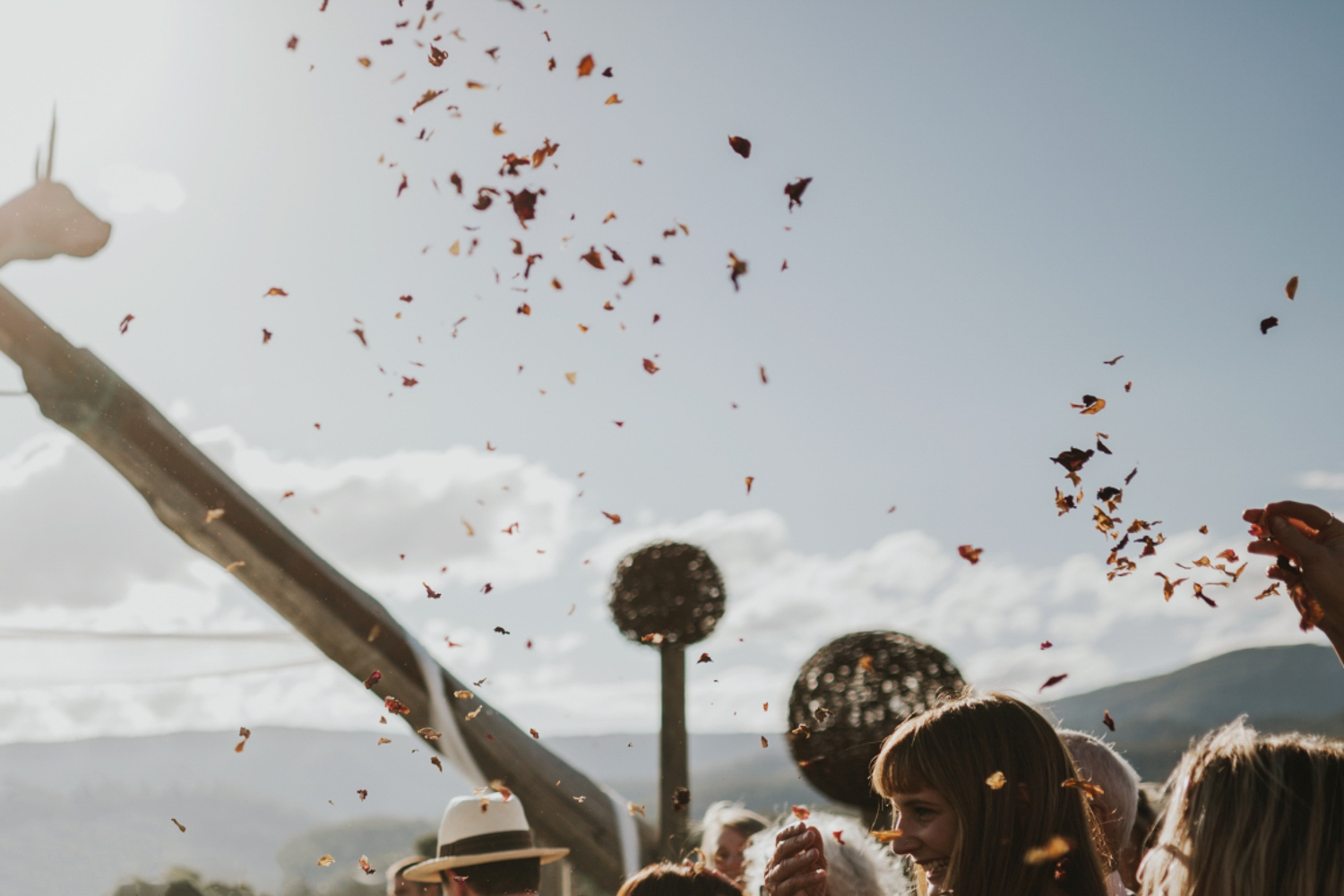 petal confetti is thrown in to the air after a wedding ceremony at willie smiths apple shed.