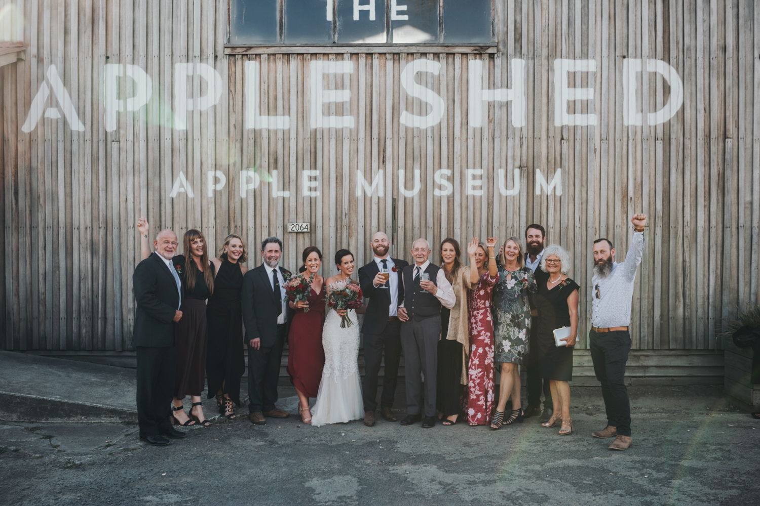Beautiful wedding portrait of a family at the apple shed Hobart.