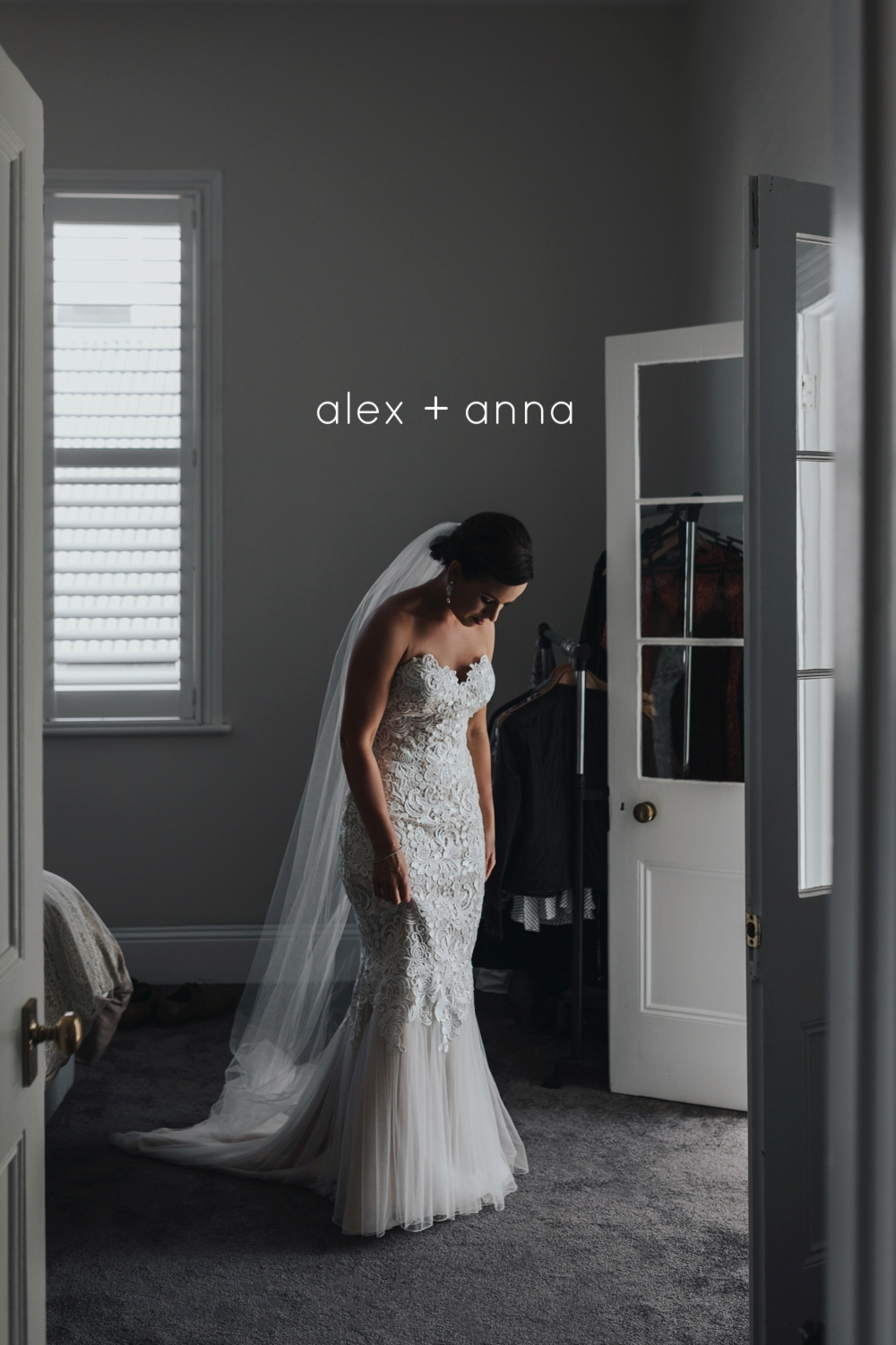Bride checks her dress in a beautiful house before her wedding day.