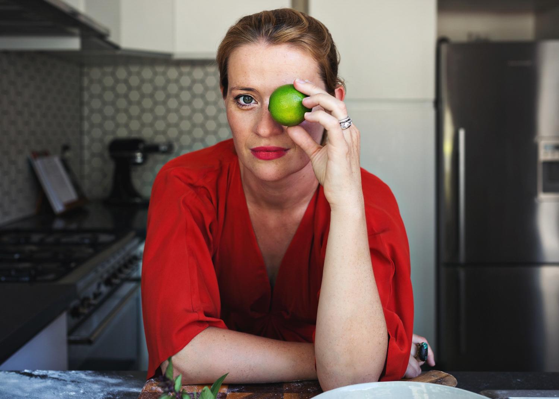 Food writer holds lime over eye during branding photo shoot in Sydney Australia.