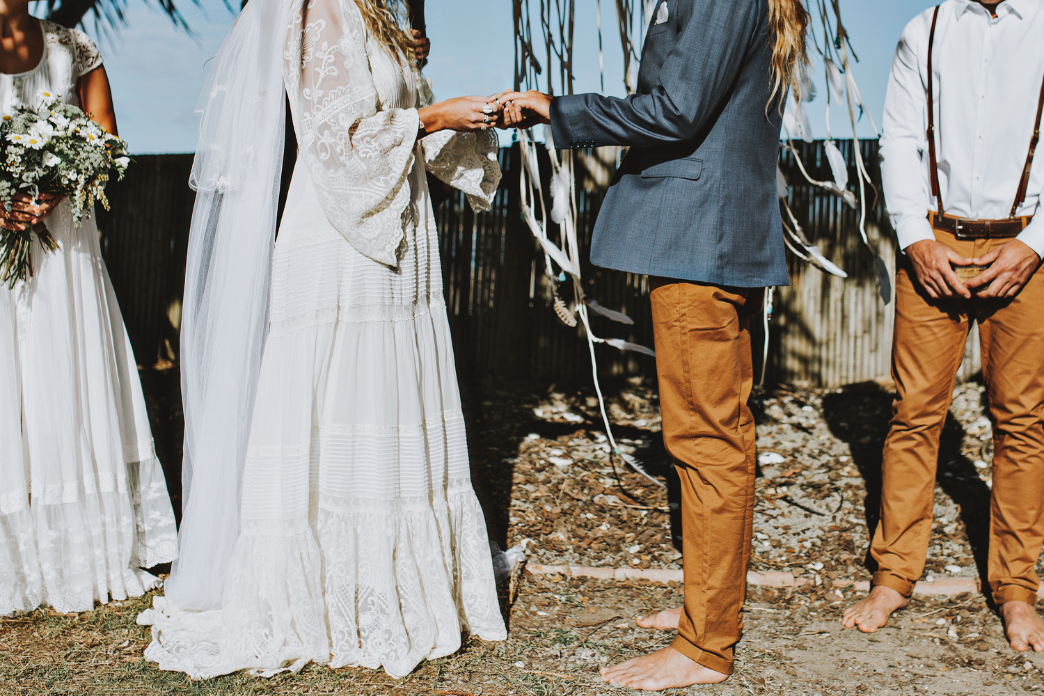 Exchange of rings at boho wedding ceremony in Byron Bay.