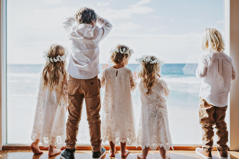 Children wait by window for wedding ceremony to begin.