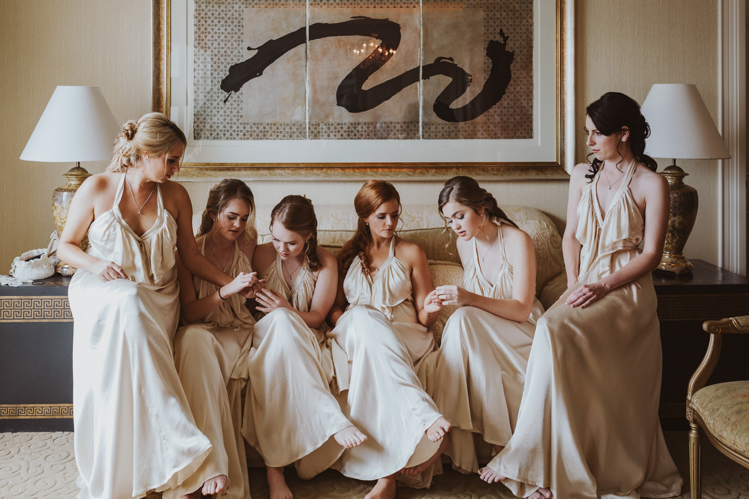 Bridesmaids compare nails in hotel room at Brisbane wedding.