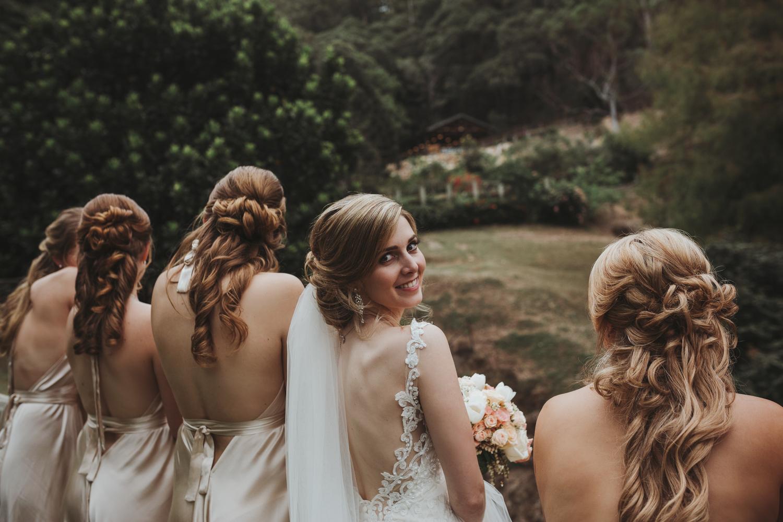 Bride smiles at camera at wedding in Brisbane.