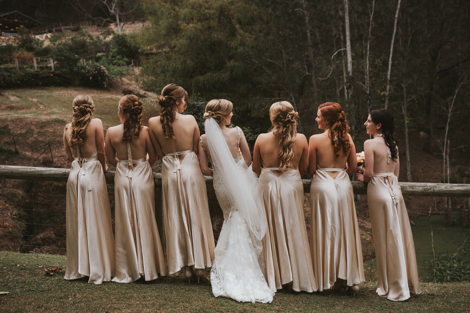 Bridesmaids and bride pose for portrait after wedding in Mount C