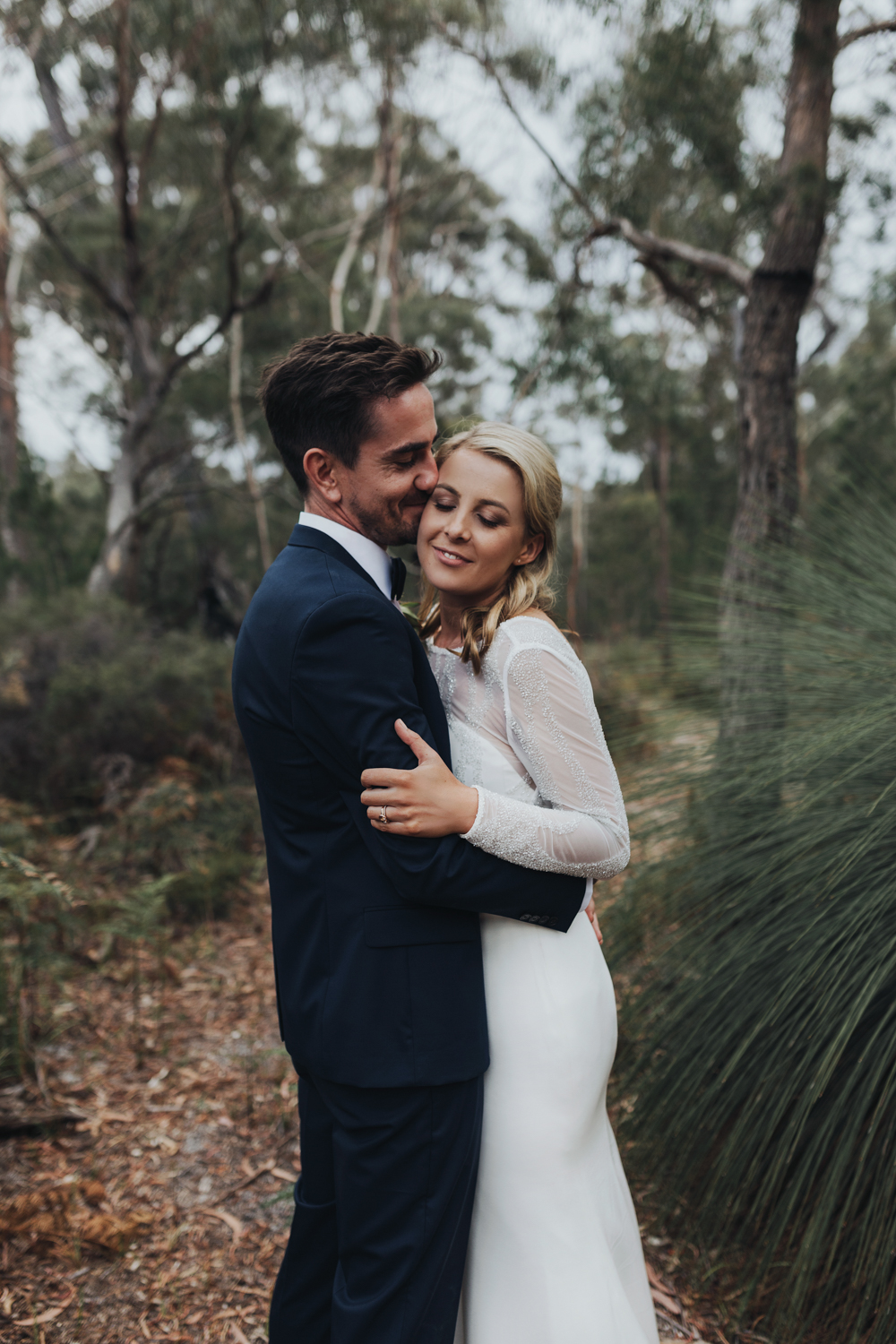 Bride and groom embrace after wedding at Bay of Fires Bush retre