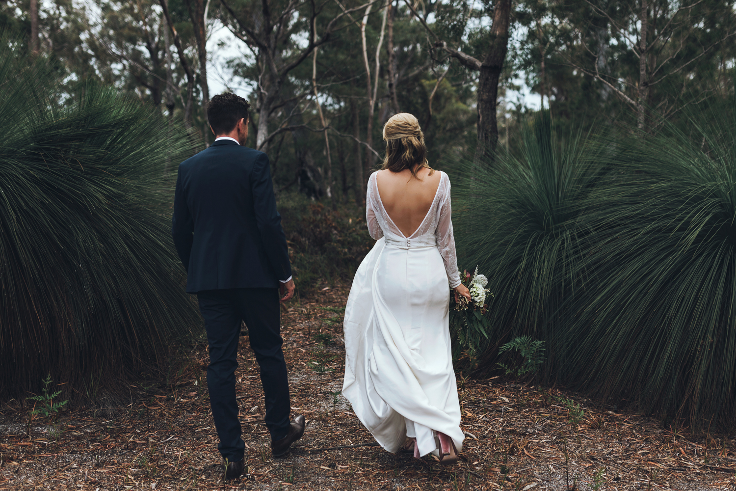 Bride and groom walk into forest at Bay of Fires bush retreat we