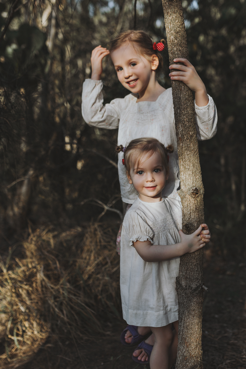 Sisters play in forest during beautiful photo session in Brisban