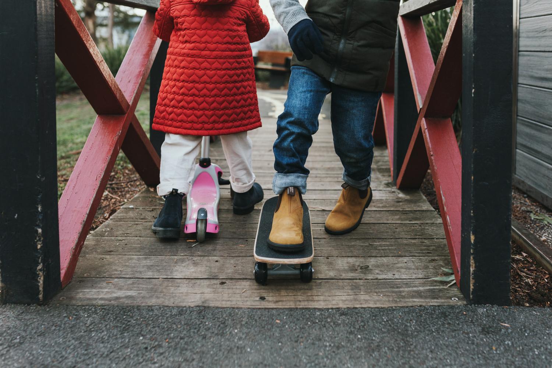 Children skateboard in suburban playground wearing Blundstone boots in Tasmania.