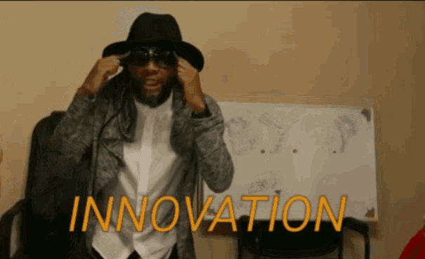 """Image: man in sunglasses and a hat with his fingers to his temples with the text """"innovation"""" in capital letters."""