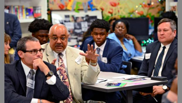 U.S. District Judge Brian Davis asks a question of a participant in an Evac Movement forum in May. The class at Lee High School hosted Mayor Lenny Curry, Sheriff Mike Williams, and a group of judges, attorneys and city leaders at its second annual At-Hope Youth Advisory Forum. (Bob Mack/Florida Times-Union)