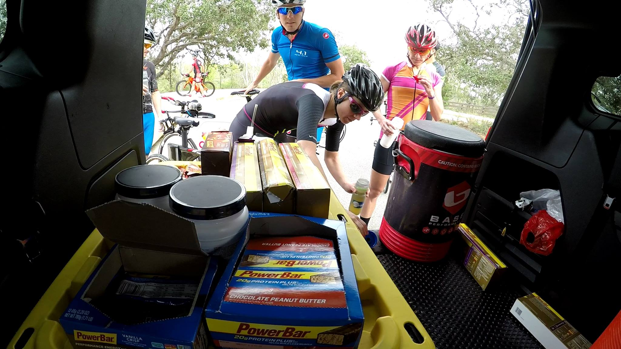 Refueling with PowerBar and BASE at the QT2 vehicle during a long ride at camp.  Photo Credit: Pedro Gomes