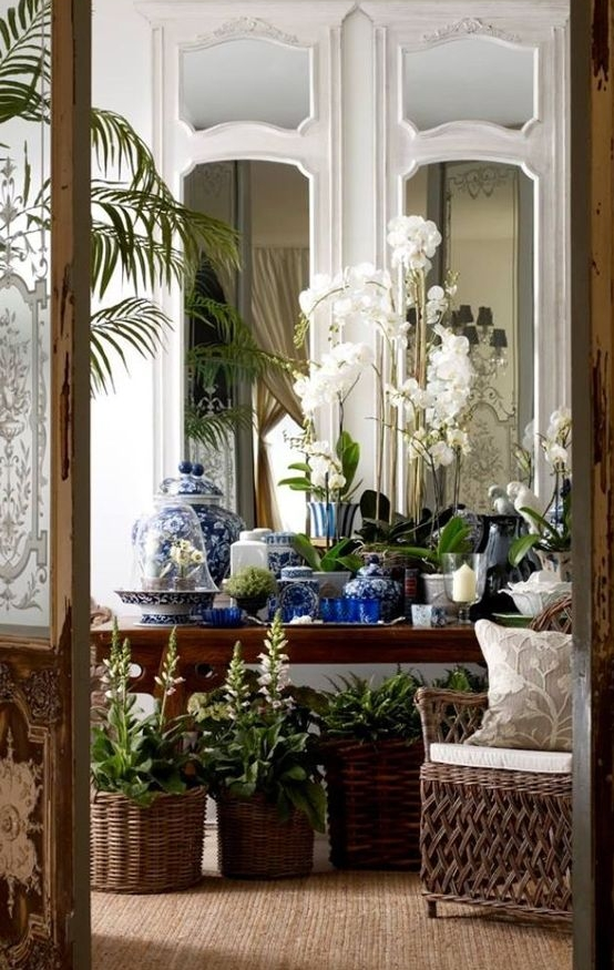 As much as we love our flowers, in our hot summers they just don't last. Using potted flowering plants and greenery adds beauty and texture to any home interior.