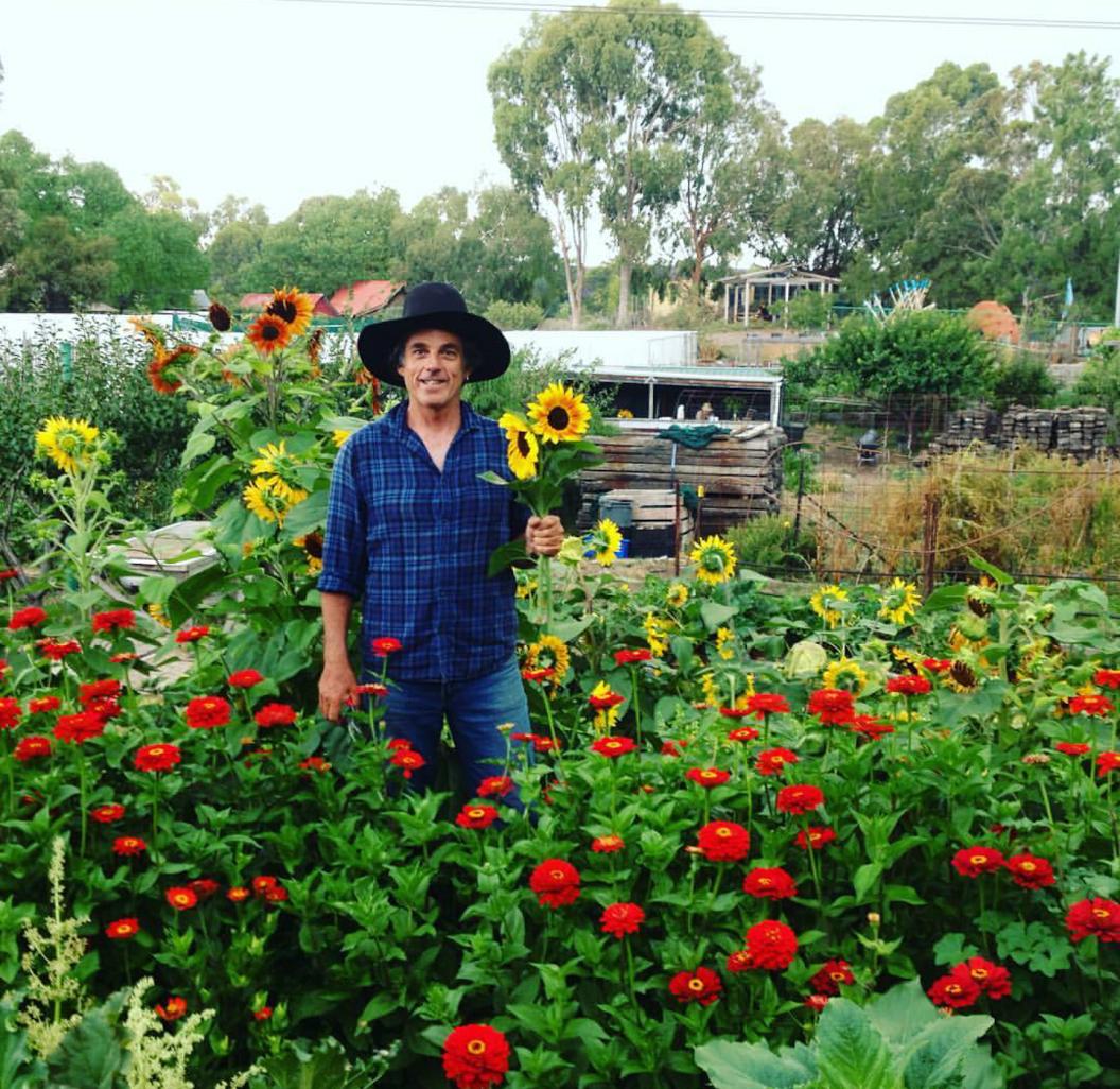 Farmer Steve and flowers Feb 2016.png