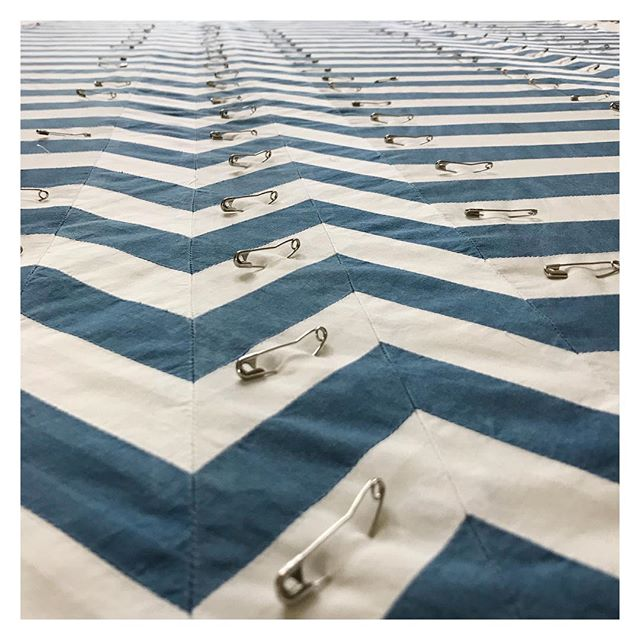 Over 150 little safety pin soldiers keeping everything in place . . . . . #oneyearinthemaking #ND18