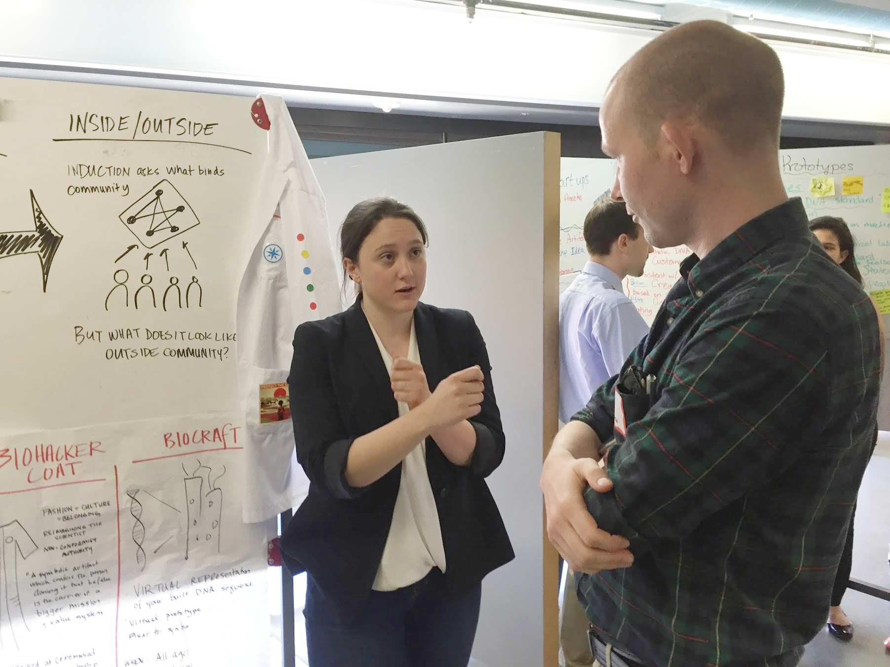 Business and policy student Kate O'Gorman describes her team's behavior change prototypes to a visiting expert during a Design Thinking for Public Policy Innovators design review.