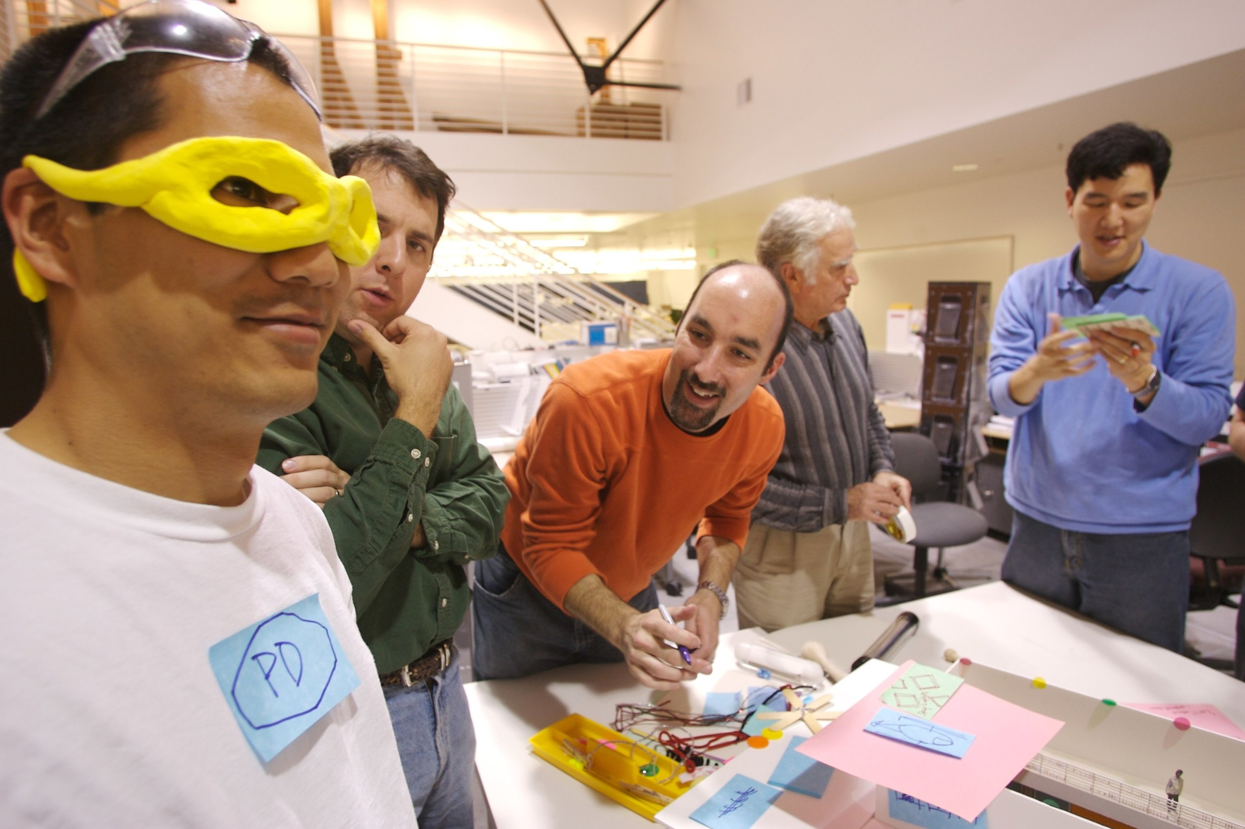 George Kembel and Bernie Roth engage students in an early d.school class prototype.