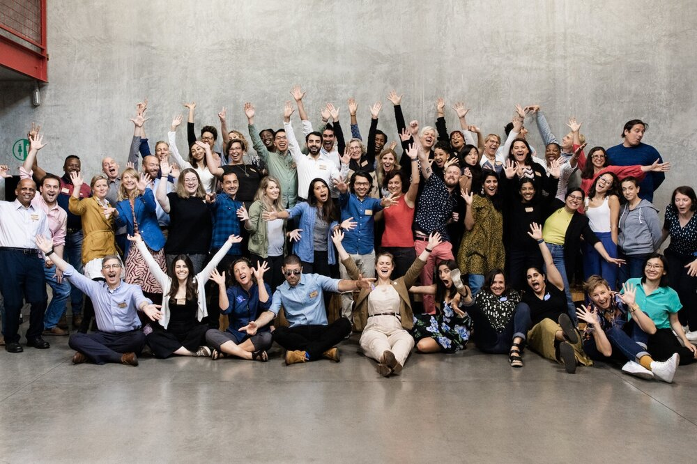 Workshop+participants+smiling+with+hands+up