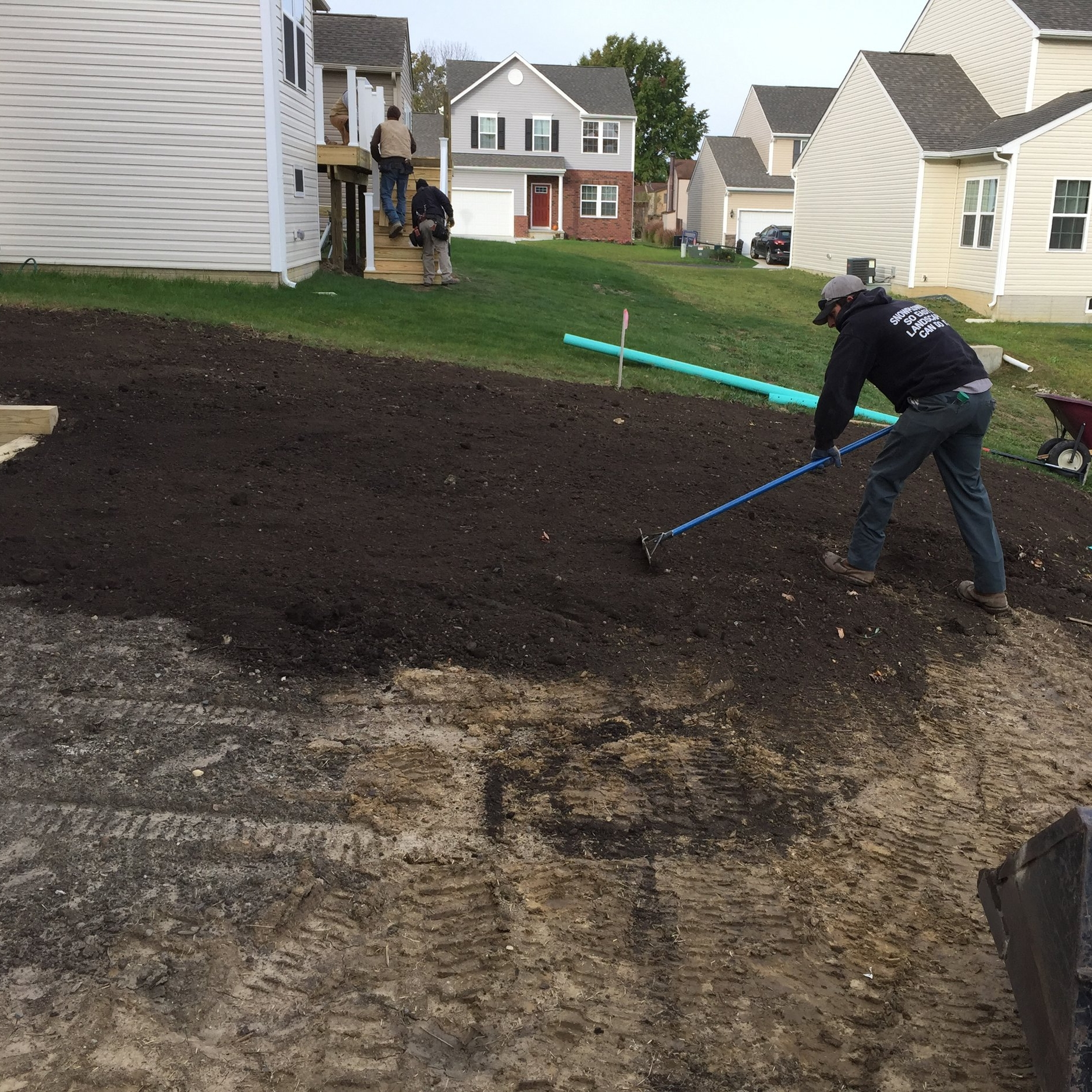 Jordon preparing the sloped yard for the new lawn!