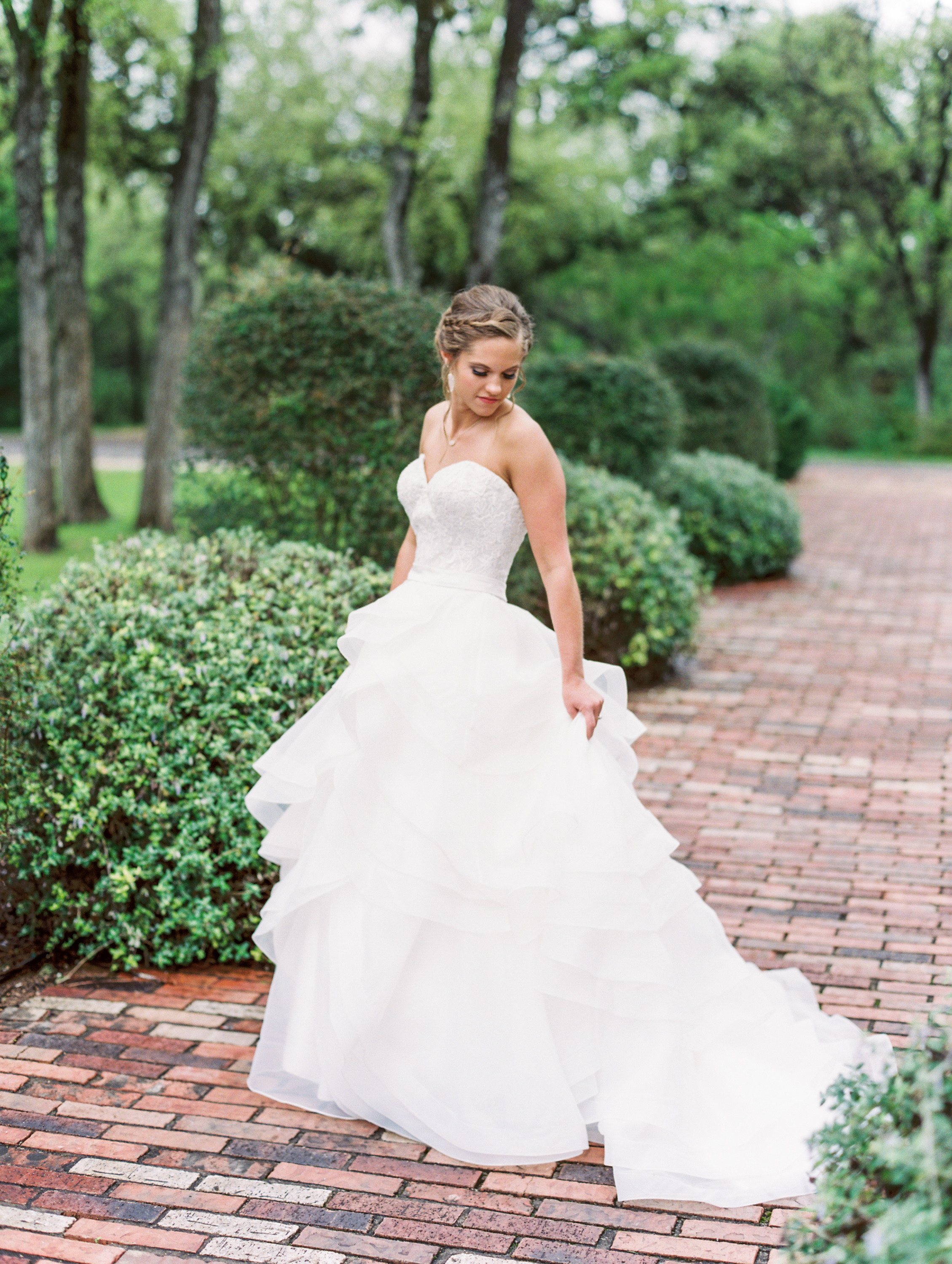 Hill Country Spring Wedding at Red Bud Hall | Austin Wedding Photographer | Film Wedding Photographer | Britni Dean Photography | Rainy Day Wedding Inspiration | ruffle wedding dress