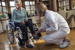 """""""nurse with senior woman in wheelchair at home"""" by  command care , via flickr, Small photo depicting handout, alzheimer""""s & caregiving page,  Creative commons  04/05/2018"""