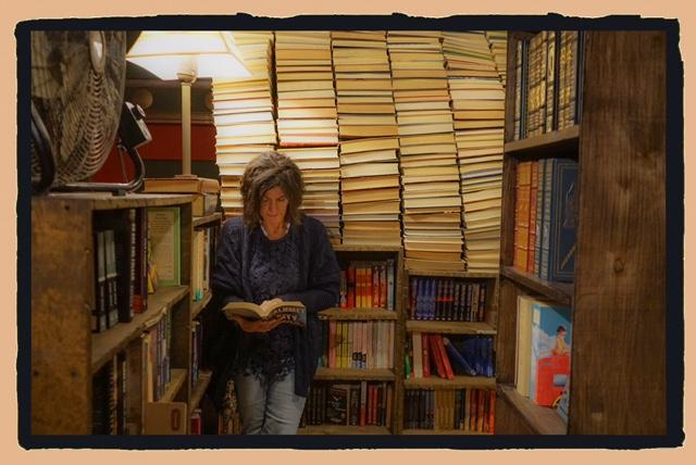 Bio pic standing reading in LA library.JPEG