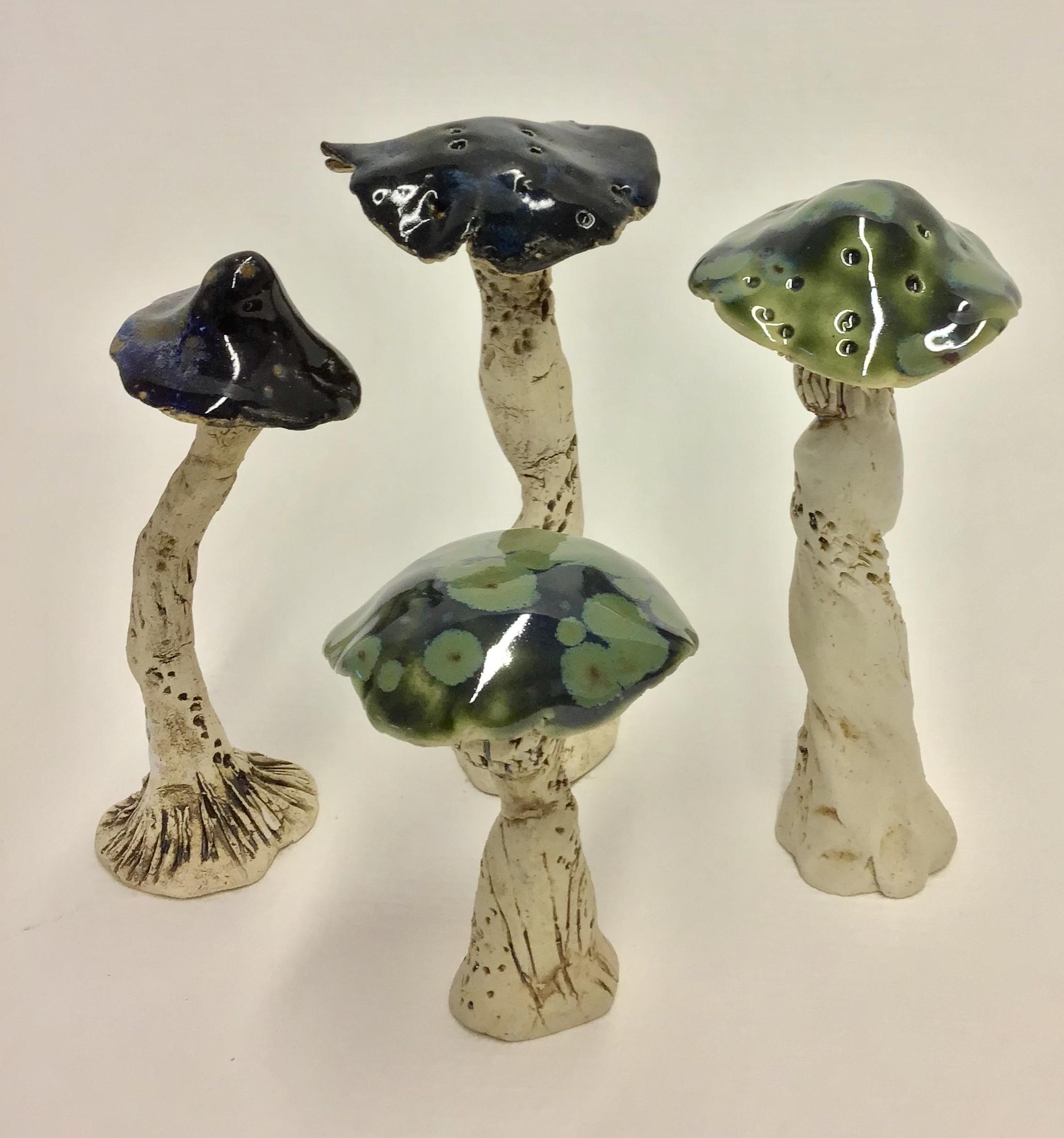 """Mushroom 1""  stoneware, 3x1x5 (2019)   ""Mushroom 2""  stoneware, 2x2x5 (2019)   ""Mushroom 3""  stoneware, 3x3x4 (2019)   ""Mushroom 4""  stoneware, 2x2x5 (2019)"