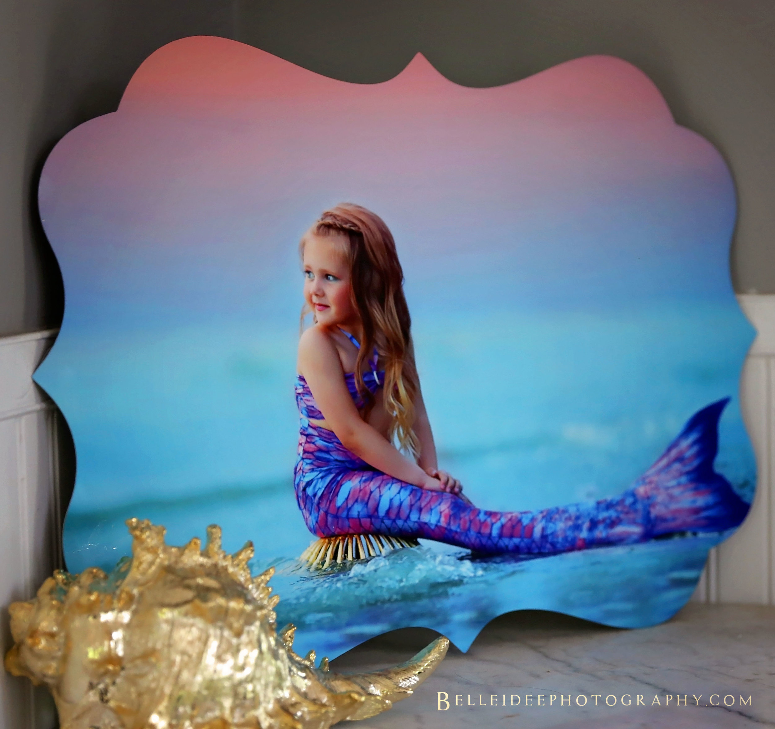 "Luxe Metal - Your image printed on a uniquely shaped metal. Comes with a ""float mount"" on the back to give the illusion that your image is floating off the wall.(My FAVORITE option for Mermaid sessions)"