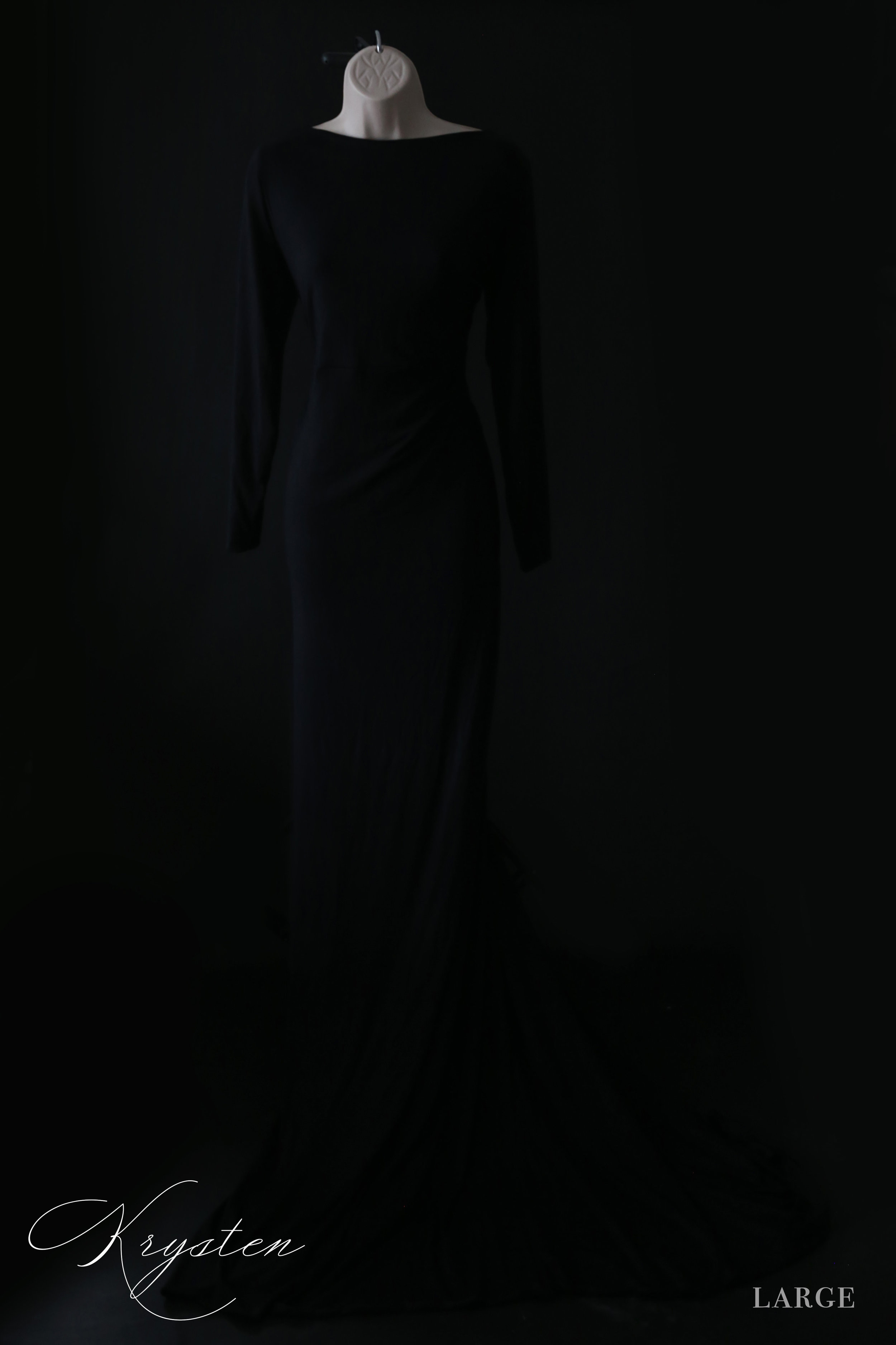 Krysten - Large Elegant, glamourous, and classic. This dress could look beautiful in an urban location, in a field of rich greens, against a white winter scene, or very magazine Vogue-esque in studio.