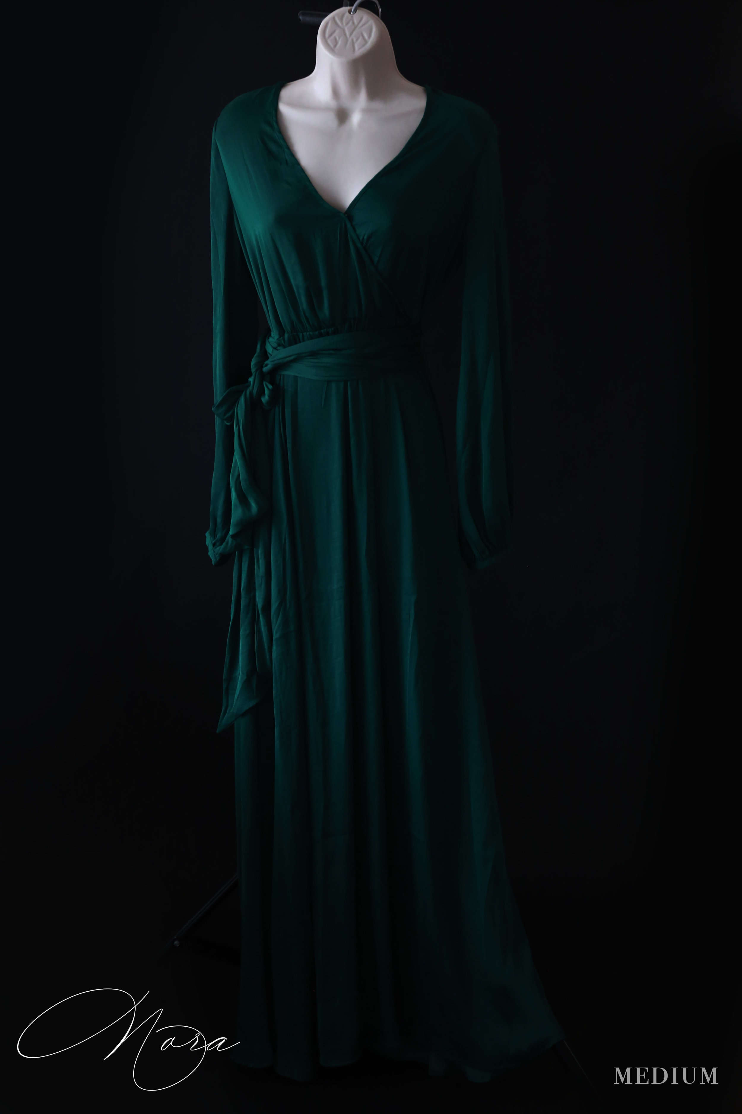 Nora - MediumA beautiful satin-like material and rich emerald tones, this dress is great for a mom looking for a more dressed-up look.Also in a Mustard Gold (see the Dakota below)