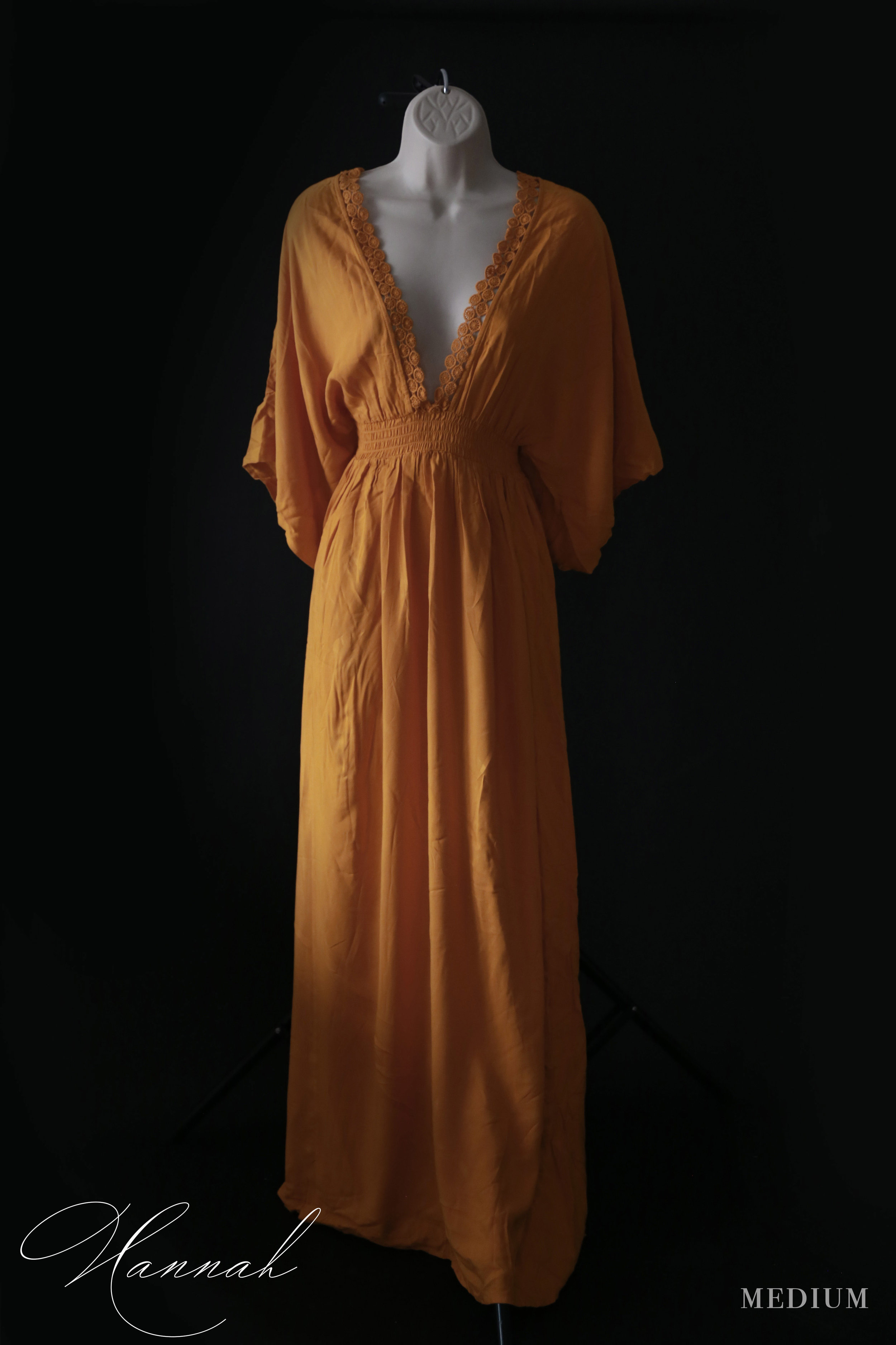 Hannah - MediumKimono style sleeves, empire waist, deep V-neck with crochet trim….this dress would look great on a maternity or non-maternity mom.