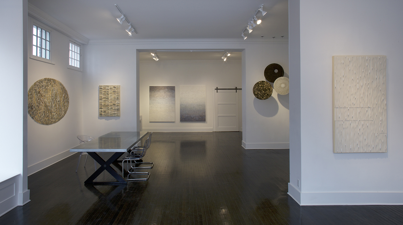 The gallery is a lovely space for this group of work. Here, left to right are: Jessica Drenk book sculptures Bibliophylum and Spine, Peagan Brooke's paintings, hanging sculptures made of pins by Beth Dary, and Jessica Drenk PVC pipe piece, Erosions.