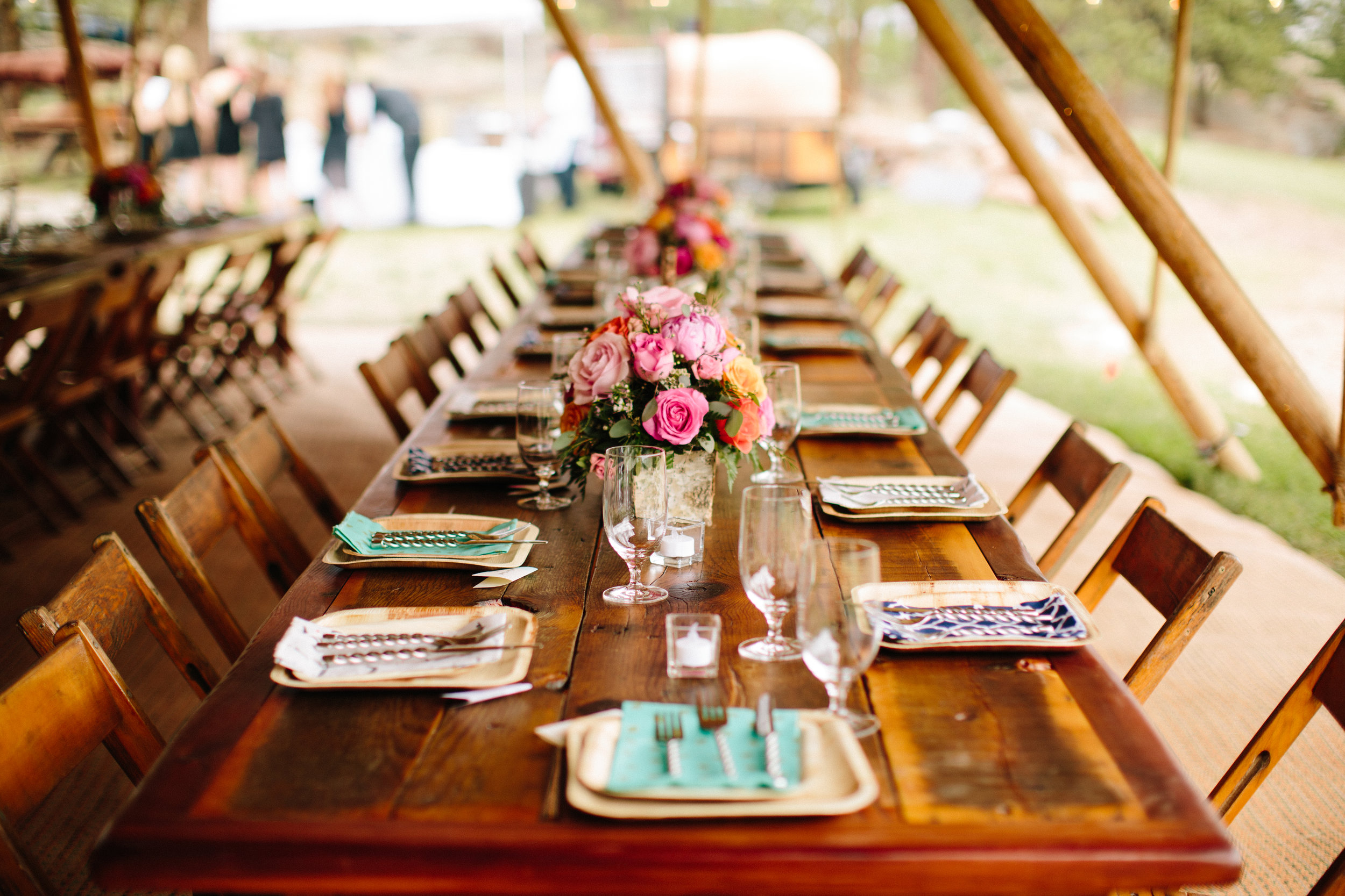Rustic wood tables and chairs from The Harvest Table Company  Rentals from Colorado Party Rentals  Flowers from Evanscraft Designs