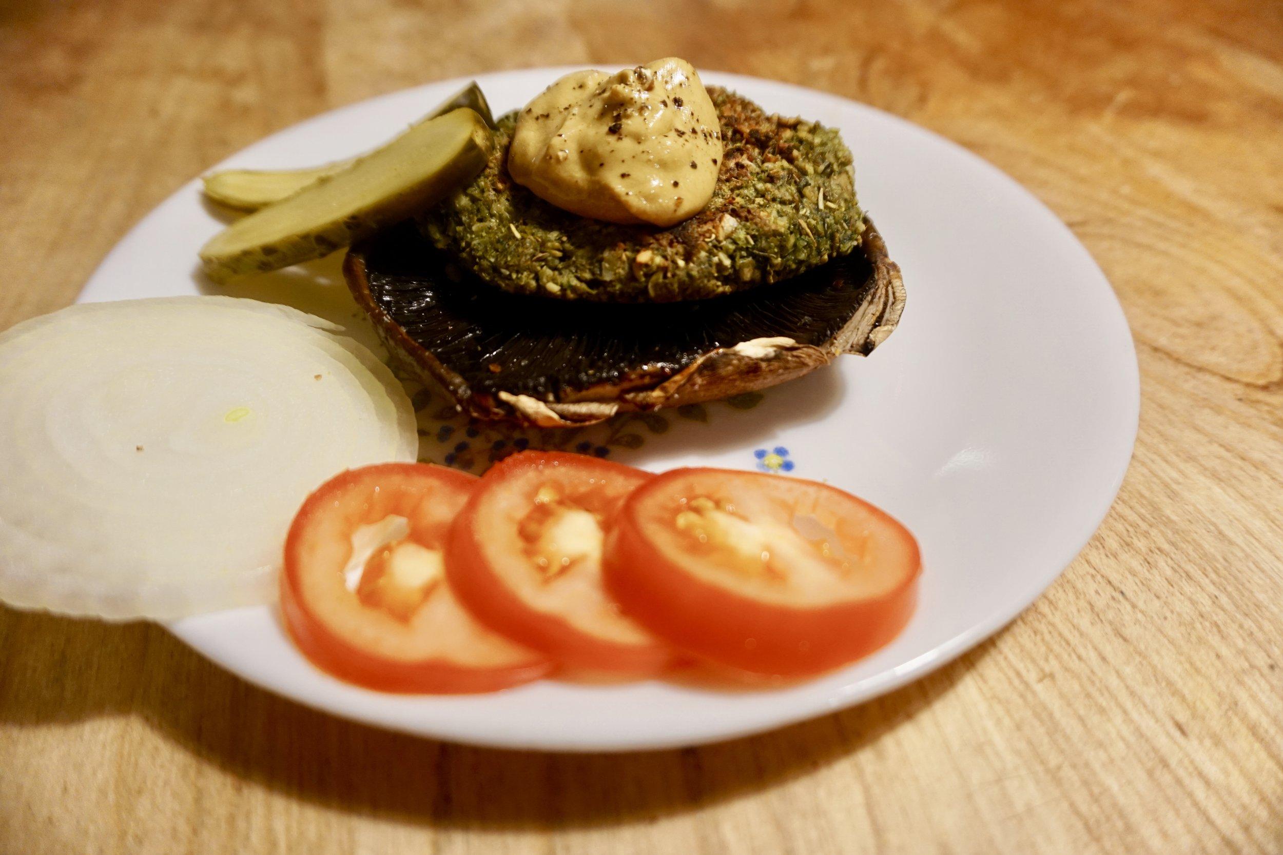 Lentil burger served on a portobello mushroom.