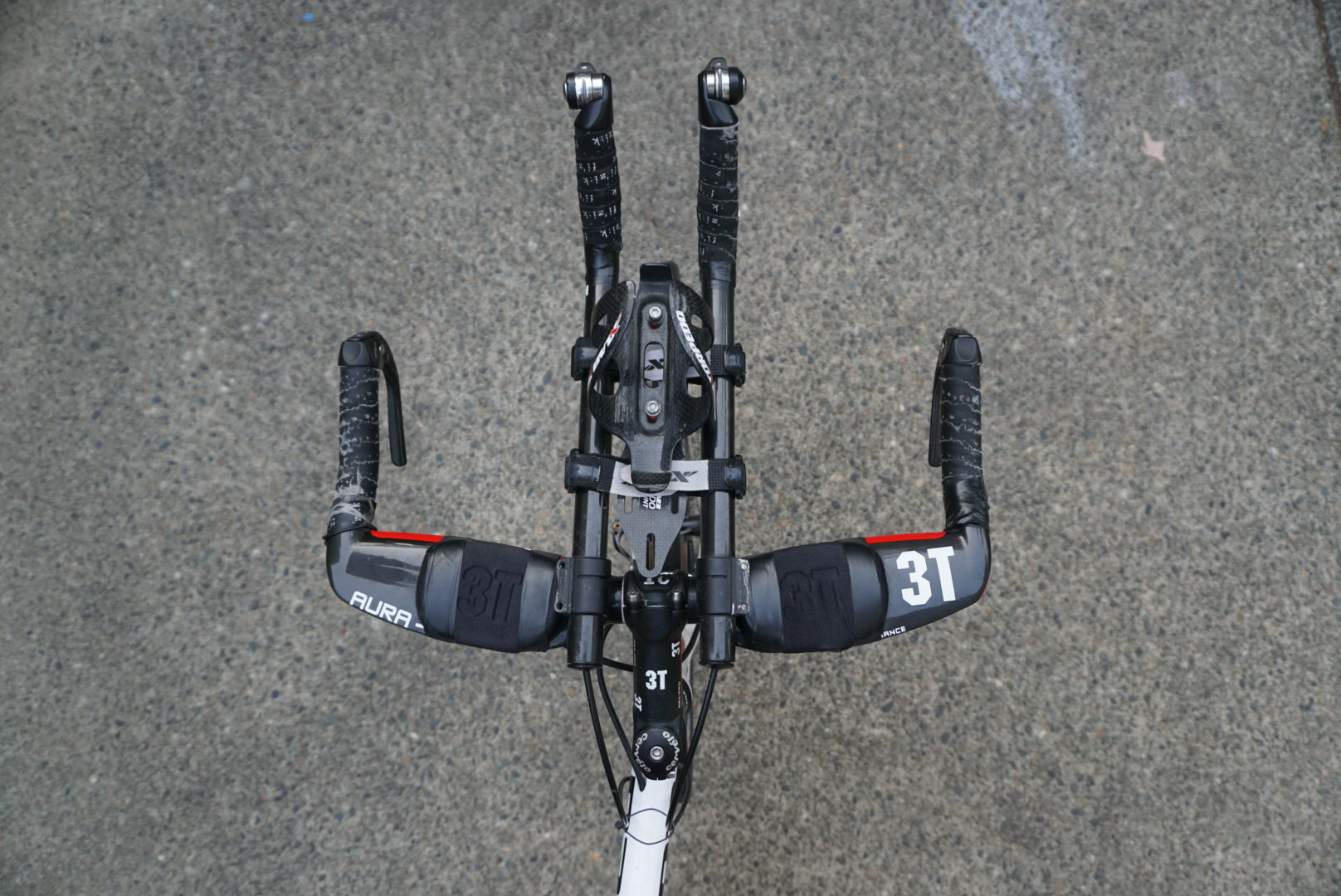 My new and improved aero bars. Notice the electrical tape.