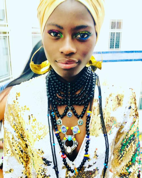 Model wearing 'Golden Girl' dress